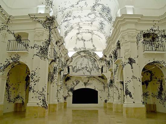 30,000 swarming paper moths consume gallery walls