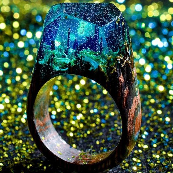 Enchanting miniature worlds inside wooden rings by Secret Wood