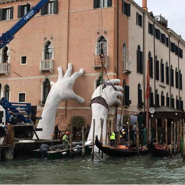 Lorenzo Quinn's Support sculpture braces Ca' Sagredo Hotel at the Venice Art Biennale 2017